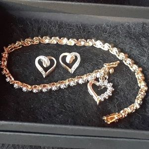 Gold Bracelet with Diamond Accents and Heart Charm